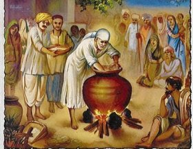 Sai Baba serving the poor